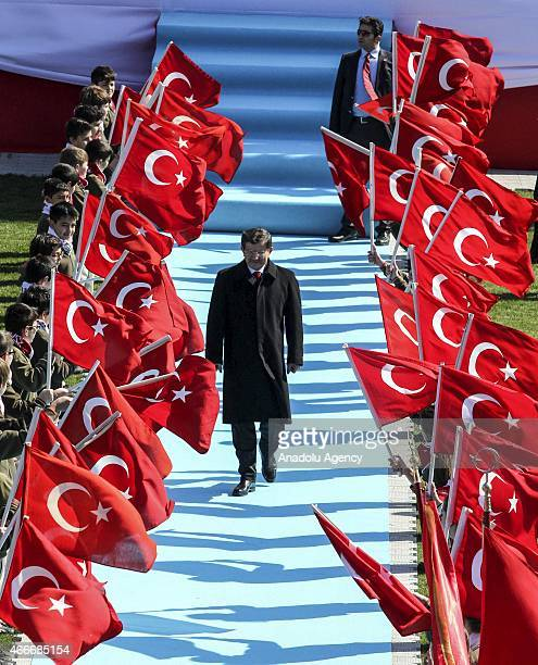 Turkish Prime Minister Ahmet Davutoglu walks through the children holding Turkish flags as he attends a ceremony to mark he 100th anniversary of...