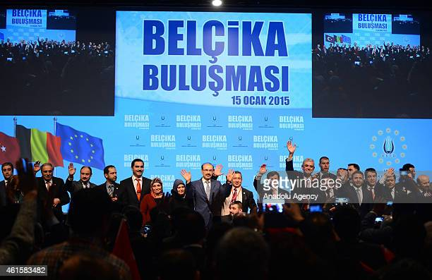 Turkish Prime Minister Ahmet Davutoglu waves after he meets with members of the community for Turkish in Belgium at on January 15 in Brussels Belgium