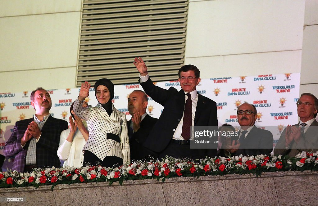 Turkish Prime Minister Ahmet Davutoglu (2nd R) with his wife Sare (2nd L) wave to his supporters from the balcony of the AK Party headquarters June 7, 2015 in Ankara, Turkey. Partial results from Turkey's parliamentary election on Sunday put the ruling AK Party on 40.8 percent of the vote, a result which will leave it struggling to form a stable government for the first time since it came to power more than a decade ago. The results put the pro-Kurdish Peoples' Democratic Party (HDP) at 13.6 percent, just above the 10 percent threshold needed for it to enter parliament.