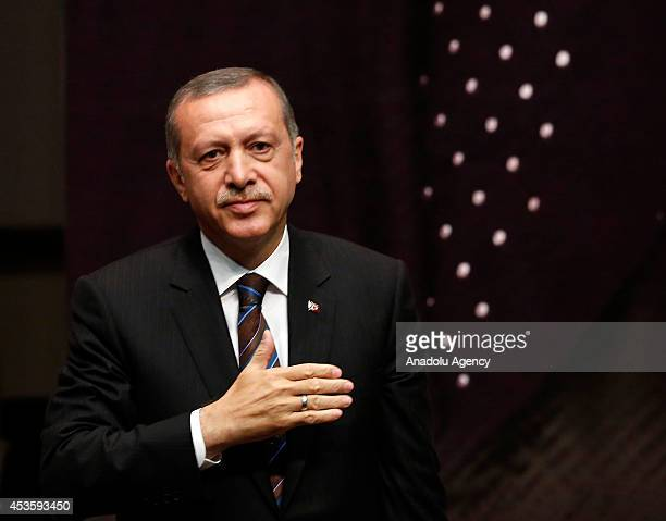 Turkish Prime Minister and Presidentelect Recep Tayyip Erdogan gestures during the meeting of provincial chairmen of his Justice and Development...