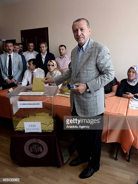 Turkish Prime Minister and Presidential candidate Recep Tayyip Erdogan casts his ballot in Turkey's Presidential election at a polling station in...