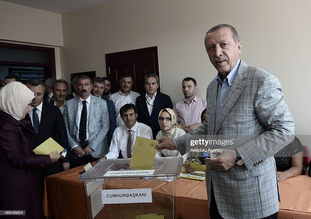 Turkish Prime Minister and Presidential candidate Recep Tayyip Erdogan casts his ballot in Turkey's Presidential election at a polling station in Istanbul, Turkey on August 10, 2014. Millions of Turkish voters go to the polls on Sunday for an election in which for the first time the president will be elected by popular vote.