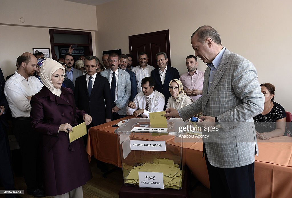 Turkish Prime Minister and Presidential candidate Recep Tayyip Erdogan (R) casts his ballot in Turkey's Presidential election at a polling station in Istanbul, Turkey on August 10, 2014. Millions of Turkish voters go to the polls on Sunday for an election in which for the first time the president will by popular vote.