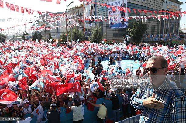 Turkish Prime Minister and Presidential Candidate Recep Tayyip Erdogan greets his supporters during a rally in Van Turkey on July 31 2014 Photo by...