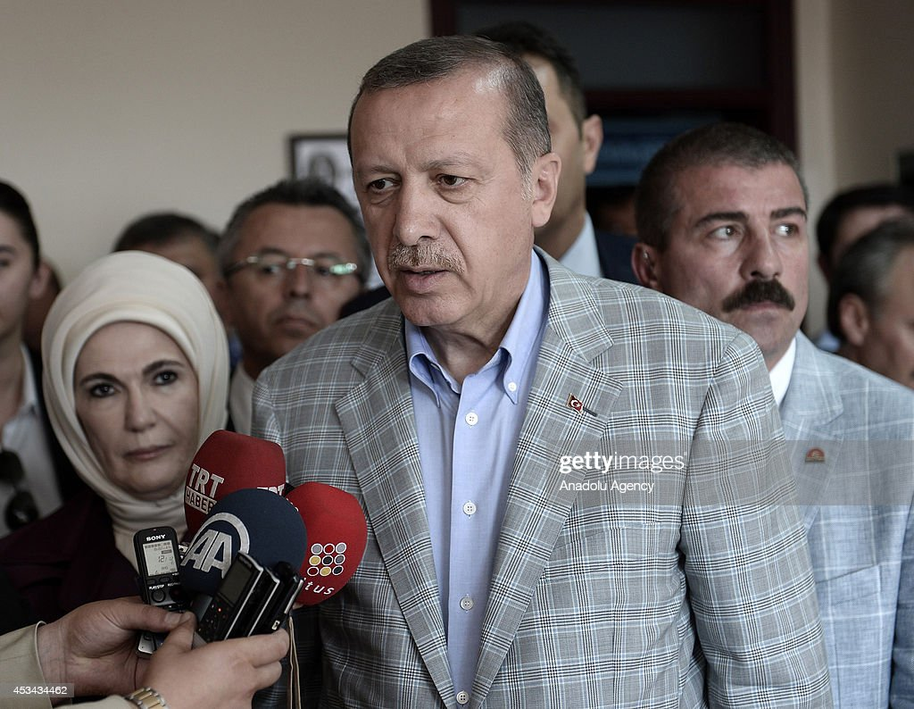 Turkish Prime Minister and Presidential candidate Recep Tayyip Erdogan speaks to the media after casting his ballot in Turkey's Presidential election at a polling station in Istanbul, Turkey on August 10, 2014. Millions of Turkish voters go to the polls on Sunday for an election in which for the first time the president will by popular vote.