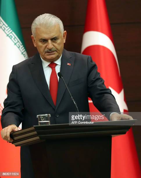 Turkish Prime Minister Binali Yildirim addresses a joint press conference with Iran's First Vice President Eshaq Jahangiri at Cankaya Palace in...