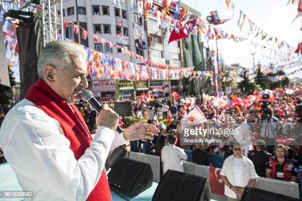 Turkish Prime Minister Binali Yildirim addresses the crowd during Turkey's ruling Justice and Development Party's rally in Van Turkey on June 05 2018