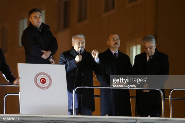 Turkish Prime Minister Binali Yildirim addresses the crowd in front of the government office in Turkey's Hakkari on November 17 2017