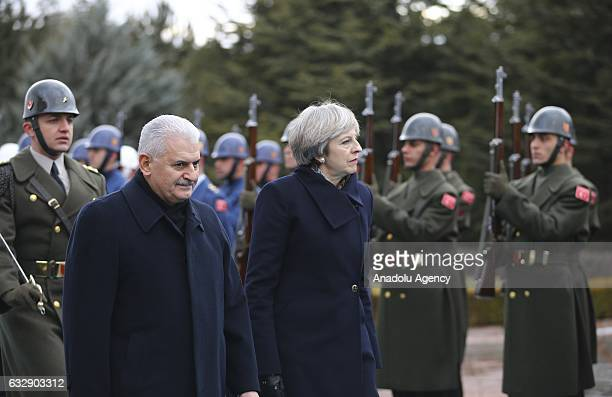 Turkish Prime Minister Binali Yildirim and British Prime Minister Theresa May walk past the guard of honor during an official welcoming ceremony at...