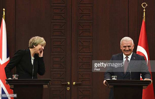 Turkish Prime Minister Binali Yildirim and British Prime Minister Theresa May attend a press conference at his ministerial building on January 28,...