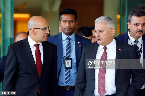 Turkish Prime Minister Binali Yildirim and Deputy Prime Minister Mehmet Simsek arrive at Singapur Changi International Airport as part of Yildirim's...