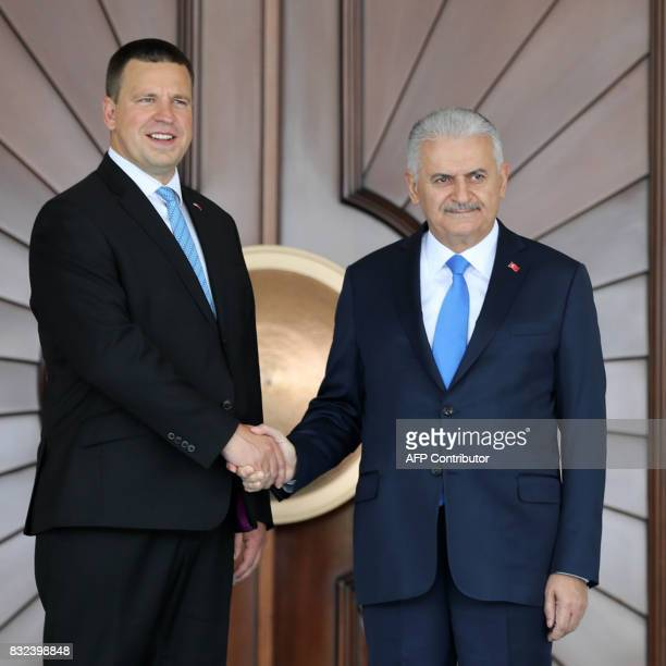 Turkish Prime Minister Binali Yildirim and Estonian Prime Minister Juri Ratas shake hands during an official welcoming ceremony prior to their...