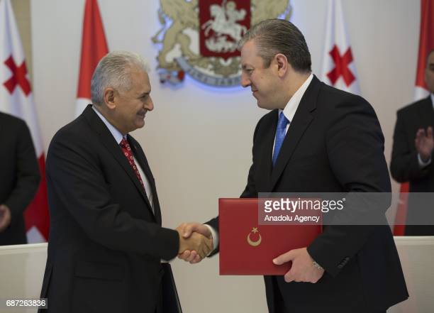 Turkish Prime Minister Binali Yildirim and Georgian Prime Minister Giorgi Kvirikashvili shake hands after signing a joint declaration between Turkey...