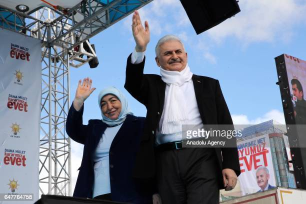 Turkish Prime Minister Binali Yildirim and his wife Semiha Yildirim greet the crowd during a meeting at Cacabey Square in Kirsehir Turkey on March 04...
