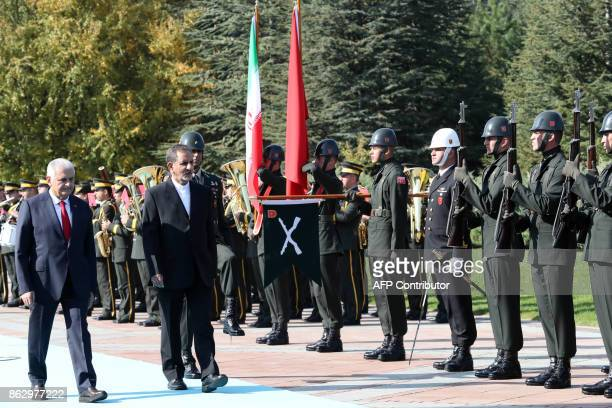 Turkish Prime Minister Binali Yildirim and Iranian First Vice President Eshaq Jahangiri review a honor guard upon Jahangiri's arrival for their...