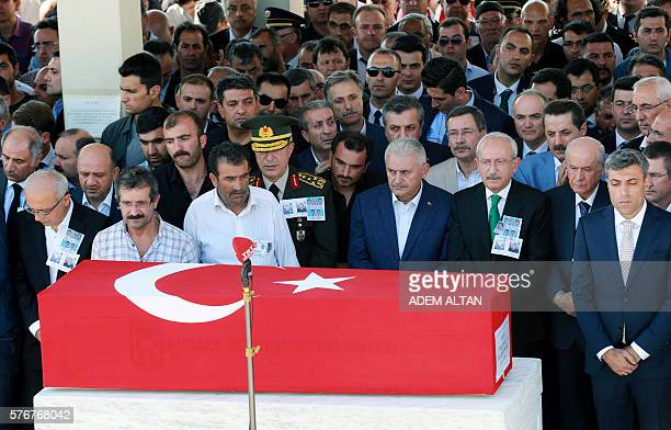 Turkish Prime Minister Binali Yildirim and leaders of the Republican Peoples Party Kemal Kilicdaroglu and the Nationalist Movement Party Devlet...