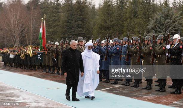 Turkish Prime Minister Binali Yildirim and Nigerian Prime minister Brigi Rafini walk past an honor guard during an official welcome ceremony at...