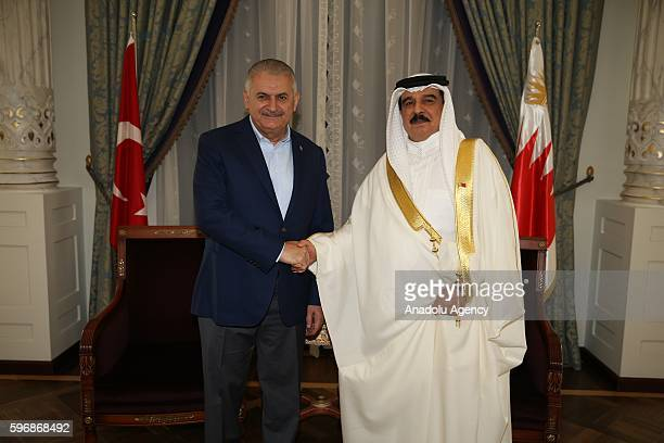 Turkish Prime Minister Binali Yildirim and the King of Bahrain Hamad bin Isa alKhalifa shake hands during their meeting at Ciragan Palace in Istanbul...
