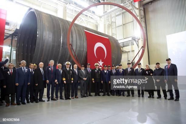 Turkish Prime Minister Binali Yildirim attends the first welding ceremony of Muratreis Submarine at Golcuk Shipyard in Kocaeli Turkey on February 25...