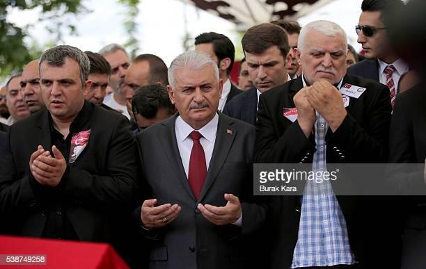 Turkish Prime Minister Binali Yildirim attends the funeral ceremonies of Turkish police officers Gokhan Topcu and Kadir Cihan Karagozlu who were...