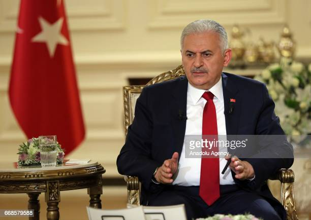 Turkish Prime Minister Binali Yildirim delivers a speech during an exclusive interview to Beyaz television at the Cankaya Palace in Ankara Turkey on...