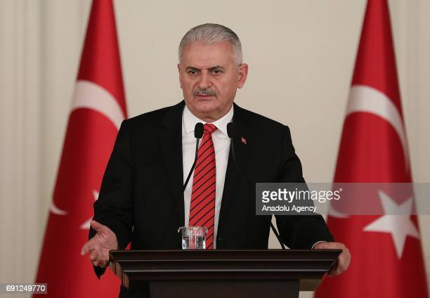 Turkish Prime Minister Binali Yildirim delivers a speech during the iftar meeting with representatives of workers civil servants unions at Cankaya...