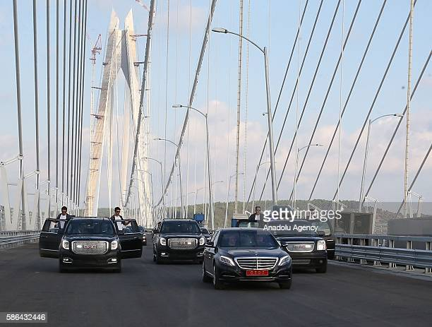Turkish Prime Minister Binali Yildirim drives his official car on the Yavuz Sultan Selim Bridge the bridge which unites the Asian and European sides...
