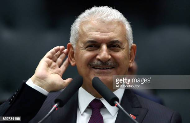 Turkish Prime Minister Binali Yildirim gestures as he delivers a speech during the AK Party's group meeting at the Grand National Assembly of Turkey...
