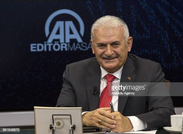 Turkish Prime Minister Binali Yildirim gestures as he is the special guest of Anadolu Agency's Editors Desk in Ankara Turkey on July 5 2018