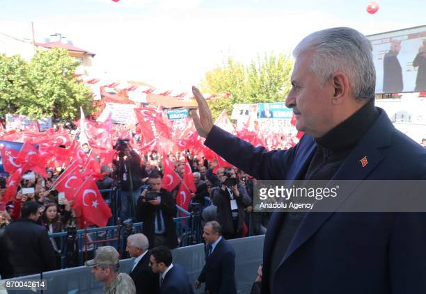 Turkish Prime Minister Binali Yildirim greets crowd during groundbreaking ceremony for new road Kemaliye Dutluca on November 4 2017 in Erzincan Turkey
