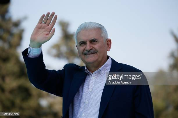 Turkish Prime Minister Binali Yildirim greets the crowd after attending AK Party's 6th ordinary provincial congress in western Izmir province Turkey...