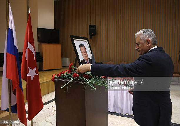 Turkish Prime Minister Binali Yildirim lays flowers to pay tribute Russian Ambassador to Turkey Andrei Karlov at the Russian Embassy in Ankara Turkey...