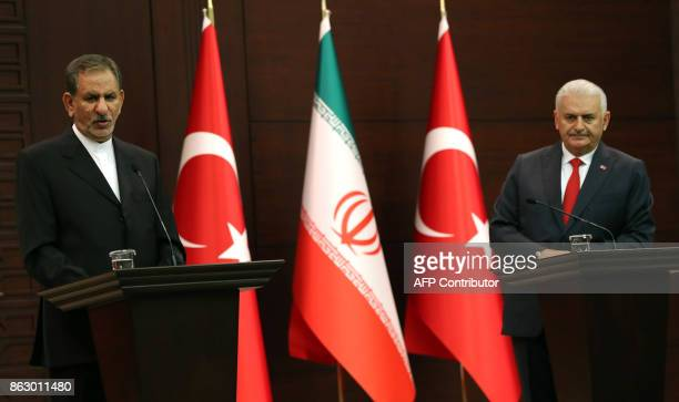 Turkish Prime Minister Binali Yildirim looks on as Iran's First Vice President Eshaq Jahangiri addresses a joint press conference at Cankaya Palace...