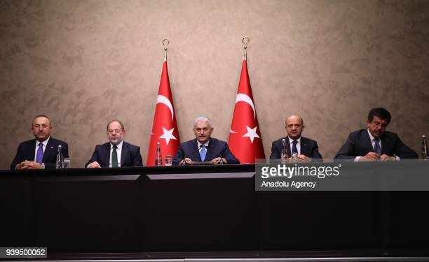 Turkish Prime Minister Binali Yildirim makes a speech as he holds a press conference at the Ankara Esenboga Airport ahead of his departure to Bosnia...