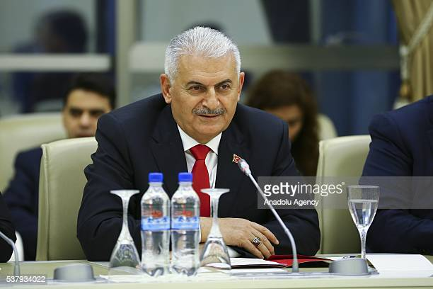Turkish Prime Minister Binali Yildirim meets with Speaker of the National Assembly of Azerbaijan Oktay Asadov in Baku Azerbaijan on June 03 2016