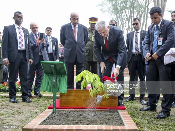 Turkish Prime Minister Binali Yildirim plants a tree in memory of his visit to the National Martyrs' Memorial at Savar Dhaka Bangladesh on December...
