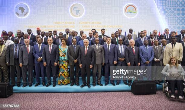 Turkish Prime Minister Binali Yildirim poses for a family photo during the TurkeyAfrica First Agriculture Ministers Meeting and Agribusiness Forum at...
