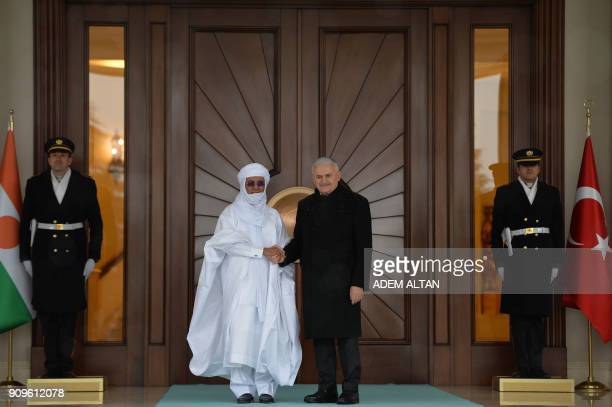 Turkish Prime Minister Binali Yildirim shakes hand with Nigerian Prime minister Brigi Rafini during an official welcome ceremony at Cankaya Palace in...