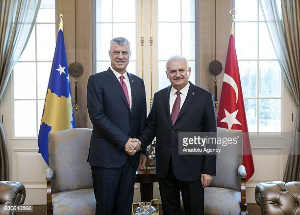Turkish Prime Minister, Binali Yildirim shakes hand with President of Kosova, Hashim Tachi as they pose during their meeting at Cankaya Palace in...