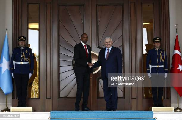 Turkish Prime Minister Binali Yildirim shakes hands with Somalian Prime Minister Hassan Ali Khayre upon his arrival at the Cankaya Palace in Ankara,...