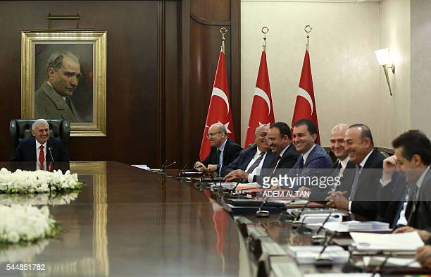 Turkish Prime Minister Binali Yildirim sits in front of a portrait of the founder of modern Turkey Mustafa Kemal Ataturk as he chairs a cabinet...