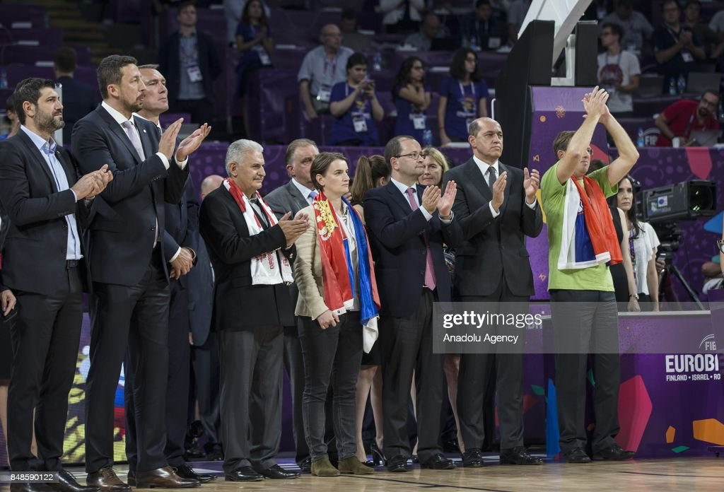 Turkish Prime Minister Binali Yildirim, Slovenian Prime Minister Miro Cerar and Serbian Prime Minister Ana Brnabic attend the cup ceremony after the FIBA Eurobasket 2017 final basketball match between Slovenia and Serbia at the Sinan Erdem Dome in Istanbul, Turkey on September 17, 2017.