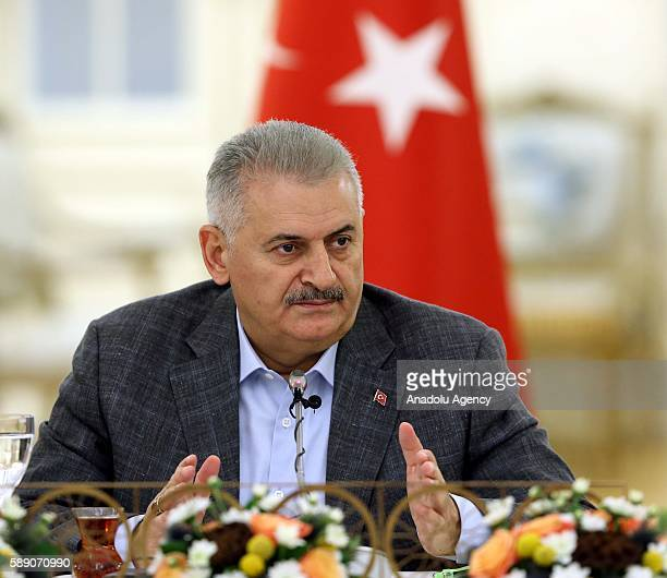 Turkish Prime Minister Binali Yildirim speaks to press members at Cankaya Palace in Ankara Turkey on August 13 2016