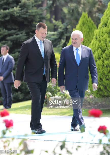 Turkish Prime Minister Binali Yildirim welcomes Estonian Prime Minister Juri Ratas during an official welcome ceremony prior to their meeting at...