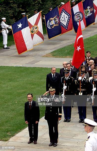 Turkish Prime Minister Bulent Ecevit listens to Turkey's National Anthem joined by Maj General Robert Ivany at a wreath laying ceremony at the US...