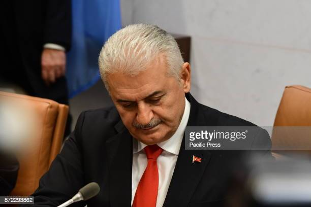 Turkish Prime Minister His Excellency Binali Yildirim greeted UN SecretaryGeneral Antonio Guterres both men pausing for a photo op with their...