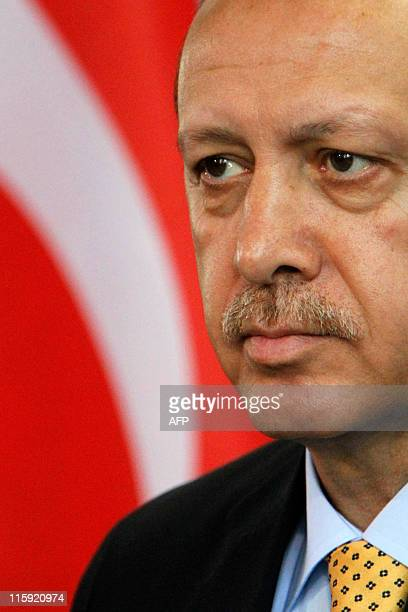 Turkish Prime Minister Recep Tayyip Erdogan addresses a press conference with German Chancellor Angela Merkel at the chancellory in Berlin on October...