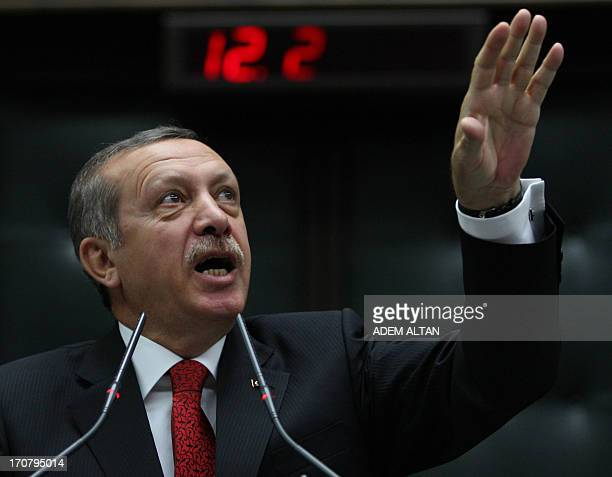 Turkish Prime Minister Recep Tayyip Erdogan addresses on June 18 2013 deputies of his ruling Justice and Development Party during a meeting at the...