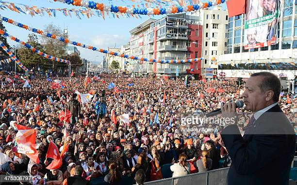 Turkish Prime Minister Recep Tayyip Erdogan addresses to the public during a local election rally organized by the ruling Justice and Development...