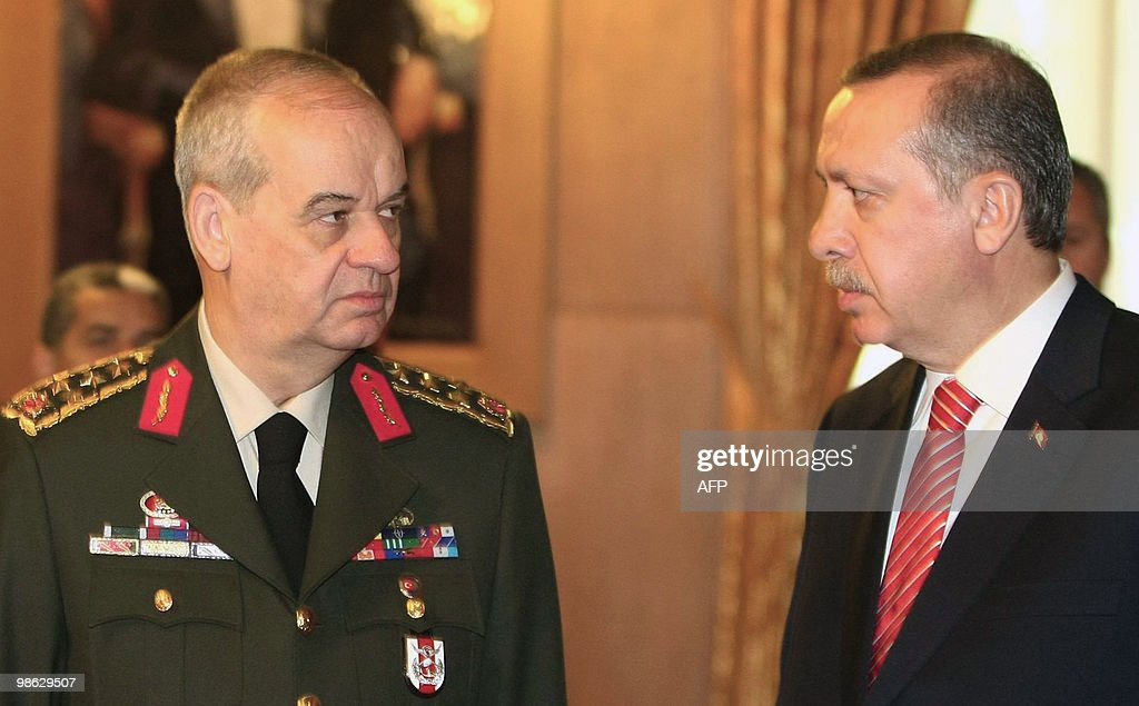 Turkish Prime Minister Recep Tayyip Erdogan (R) and Chief of General Staff Ilker Basbug (2R) stand during a ceremony at parliament on April 23, 2010 in Ankara. Turkey is celebrating the 90th anniversary of the opening of the National Assembly.